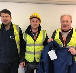 Ken Larkin receives Danone Contractor of the month safety jacket